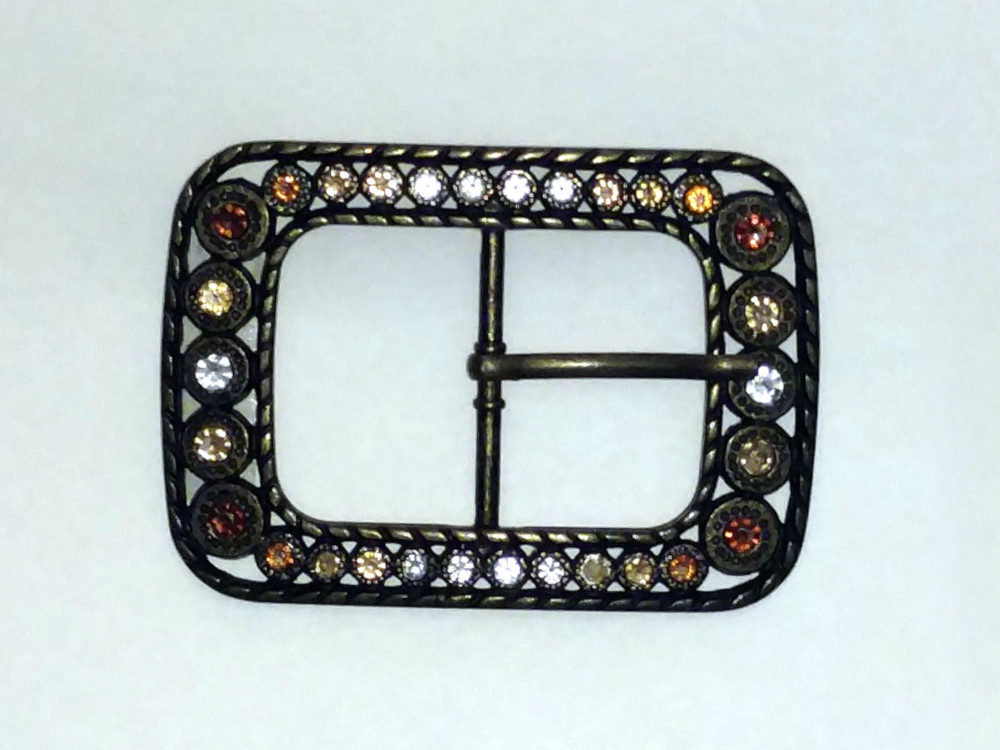 Jeweled, metal belt buckle