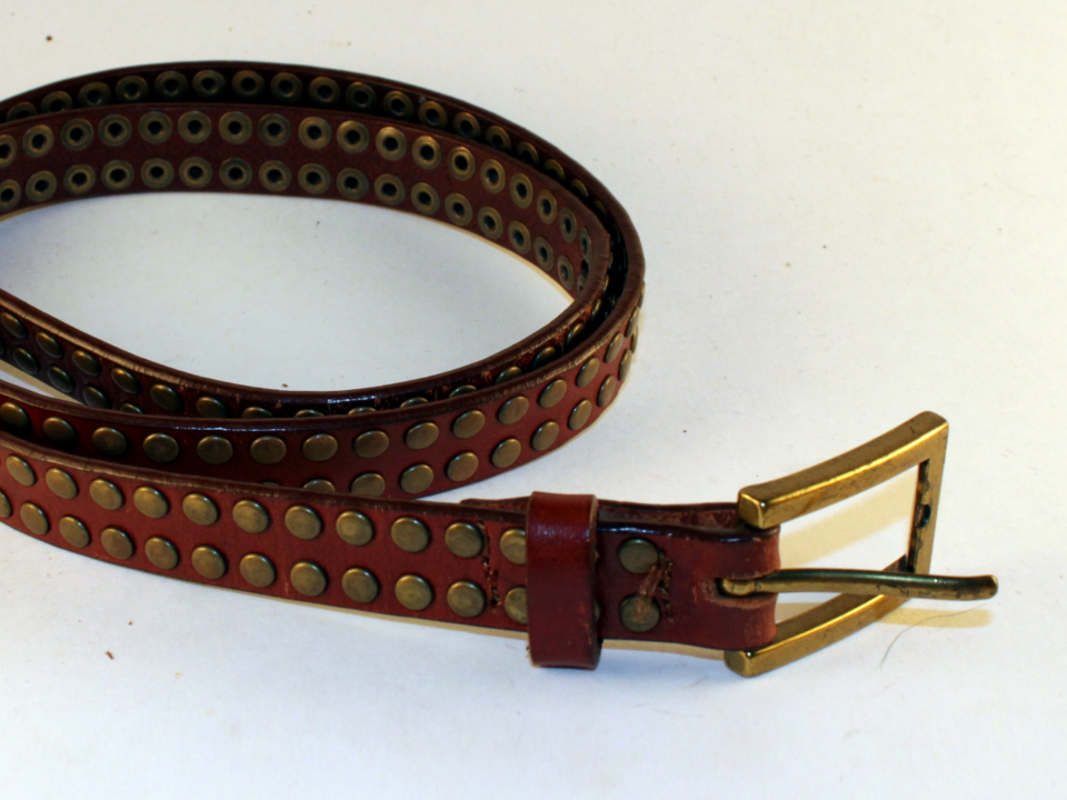 Thin, brown leather belt with rivets