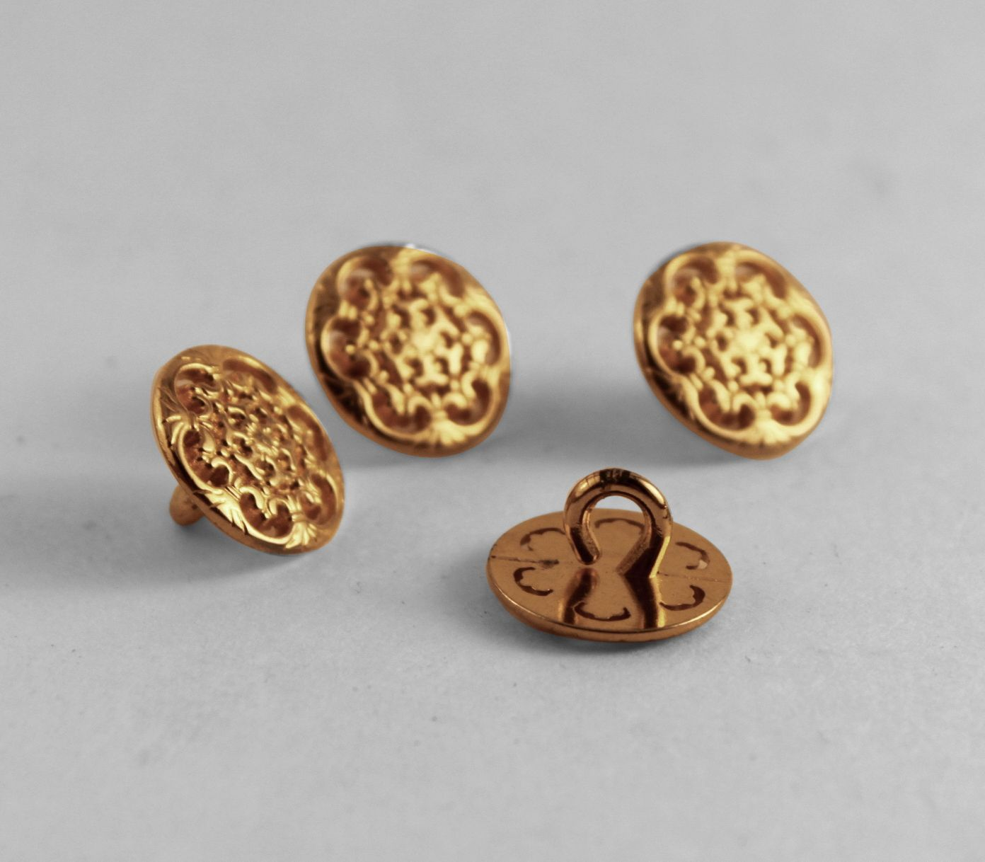 Gold tone metal buttons